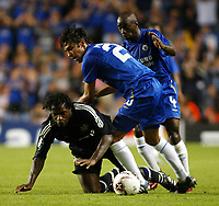 Photo: Chris Ratcliffe.<br />Chelsea v Anderlecht. UEFA Champions League.<br />13/09/2005.<br />Paulo Ferreira and Claude Makelele go in hard on Mbo Mpenza