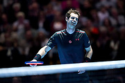 Andy Murray laughs as a Roger Federer drop shot draw him around to the opposite side of the net during the Andy Murray Live event at SSE Hydro, Glasgow, Scotland on 7 November 2017. Photo by Craig Doyle.