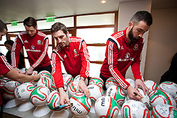 CARDIFF, WALES - Tuesday, March 4, 2014: Wales' Sam Ricketts and goalkeeper Boaz Myhill sign footballs during a signing session at the St. David's Hotel ahead of the International Friendly against Iceland. (Pic by David Rawcliffe/Propaganda)  CARDIFF, WALES - Tuesday, March 4, 2014: Wales' xxxx during a training session at the Cardiff City Stadium ahead of the International Friendly against Iceland. (Pic by David Rawcliffe/Propaganda)