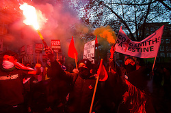 © Licensed to London News Pictures. 04/11/2015. London, UK.   Demonstrators light up flares as Thousands of students take part in a demonstration in central London against tuition fees. The rally which starts outside the University of London Union, will feature a speech from Shadow Chancellor John McDonnell.  Photo credit: Ben Cawthra/LNP