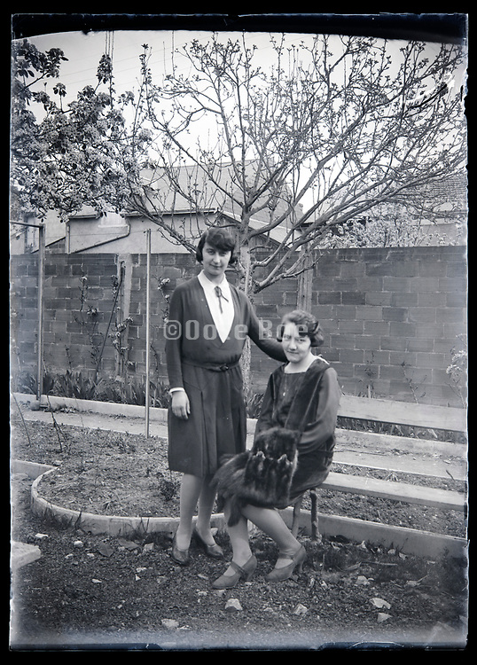 two adult woman in backyard garden France circa 1920s