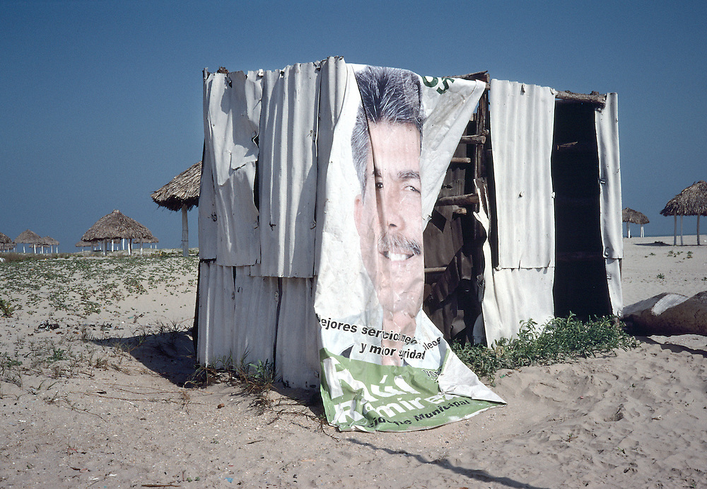 Beach changing station with election poster for door, Tamaulipas, Mexico.