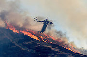 August 16, 2016 - San Bernardino, California, U.S - A helitanker drops water on the Blue Cut Fire near Lytle Creek Road in Lytle Creek Wednesday. The Blue Cut fire has destroyed an unknown number of homes. More than 1,300 firefighters and other emergency workers are battling the Blue Cut fire, which started early Tuesday 60 miles east of Los Angeles. <br /> ©Exclusivepix Media