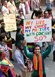 "© Licensed to London News Pictures. 25/11/2012. New Delhi, India.A man holds a banner reading ""My Life, My Choice, My Partner, With Consent, So?""  Homosexuals, bisexuals and transgenders take part in the Gay Pride Parade in New Delhi on 25 November 2012. Legalising homosexuality has had little impact on the deeply entrenched homophobia in India, where thousands of gays still face discrimination and a lack of basic rights. Photo credit : Andrew Ash/LNP"