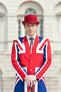 Posh British man dressed smartly in Union Jack jacket and tie.