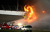 Feb 27, 2012; Daytona Beach, FL, USA; A jet drier catches fire after NASCAR Sprint Cup Series driver Juan Pablo Montoya (42) lost control of his car an collided in turn three during the Daytona 500 at Daytona International Speedway.