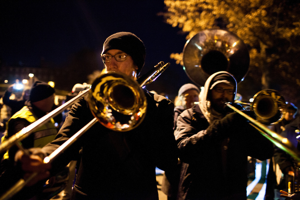 Trombone players play in a marching band as part of a protest outside the site of the WMUR/ABC News Debate at Saint Anselm College on Saturday, January 7, 2012 in Manchester, NH. Brendan Hoffman for the New York Times