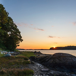 Dawn over Mackworth Island as seen from Martin Point in Portland, Maine.
