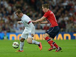 Norway's Stefan Johansen puts pressure on England's Wayne Rooney (Manchester United) - Photo mandatory by-line: Alex James/JMP - Mobile: 07966 386802 - 3/09/14 - SPORT - FOOTBALL - London - Wembley Stadium - England v Norway - International Friendly