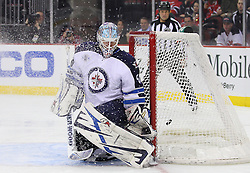 Jan 17; Newark, NJ, USA; New Jersey Devils right wing David Clarkson (23) scores a goal past Winnipeg Jets goalie Chris Mason (50) during the second period at the Prudential Center.