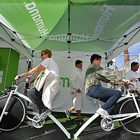 Participants ride blender bikes using pedal power to blend fruit smoothies during the Healthy Fun Fair event of Humana Challenge week in La Quinta, Calif., Saturday, January 14, 2012. (Eric Reed/AP Images for Humana)