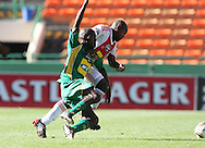 CAPE TOWN, SOUTH AFRICA - 28 MARCH 2010, Thokozani Mshengu of Golden Arrows and Enoch Shabalala of Ajax Cape Town clash in a challenge for the ball during the Telkom Knock Out match between Ajax Cape Town and Golden Arrows held at Newlands Stadium in Cape Town, South Africa..Photo by: Shaun Roy/Sportzpics