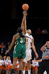 Virginia Cavaliers Forward Lyndra Littles (1) goes up for the opening tip against South Florida Bulls center Nalini Miller (32).  The Virginia Cavaliers defeated the South Florida Bulls 73-71 in the third round of the Women's NIT held at John Paul Jones Arena in Charlottesville, VA on March 22, 2007.