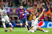 Liverpool midfielder Fabinho (3) slides in to tackle Barcelona forward Lionel Messi (10) during the Champions League semi-final leg 1 of 2 match between Barcelona and Liverpool at Camp Nou, Barcelona, Spain on 1 May 2019.