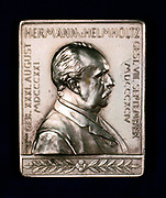 Hermann Ludwig Ferdinand von Helmholtz, c1900.  Helmholtz (1821-1894), German physicist and physiologist, inventor of the ophthalmascope (1850), was distinguished in a number of fields including mathematics and mathematical and experimental physics. Obverse of a commemorative medal.