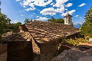 A church with a stone roof in Leshten
