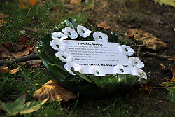 © Licensed to London News Pictures. 13/11/2011. London, UK. A wreath of white poppies lies on the floor before the service. Pledge Union White Poppy Remembrance Ceremony at the Conscientious Objectors Memorial in Tavistock Square Gardens today,  Sunday 13th Nov. Photo credit : Stephen Simpson/LNP