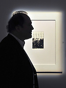 © Licensed to London News Pictures. 11/11/2011. London, UK. William Boyd silhouetted against the work.  Nat Tate's (1928 - 1960) Bridge no 114. First work to be offered for sale by fictional painter Nat Tate. Estimated to fetch 3,000 - 5.000 GBP. Nat Tate is a fictional artist created by bestselling British Author William Boyd and was part of a celebrated hoax in 1998.   Sotheby's preview of Modern and Post-War British Art which will offered for sale at auction on 15th November 2011. Photo credit : Stephen Simpson/LNP