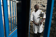 """Goma, DRC -   2014-08-28 -  Thomas Mishiki, who has has worked at Shirika la Umoja's orthopaedic workshop for 20 years in Goma, DRC on August 28, 2014. Shirika la Umoja's quality care coordinator Jean Pierre Kasuku says Mishiki, who is deaf, is the best worker they've got. """"We tip our hat to CBM,"""" Kasuku says.  Photo by Daniel Hayduk"""
