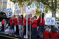 © Licensed to London News Pictures. 20/09/2019. London, UK. Young activists taking part in the Global Climate Strike demonstration gather near Parliament. Thousands of similar actions are taking place all over the UK and the rest of the world. Photo credit: Peter Macdiarmid/LNP