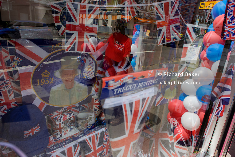 Patriotic bunting, flags, balloons and royal memorabilia on display before the Queen's diamond Jubilee in a south London shop window.