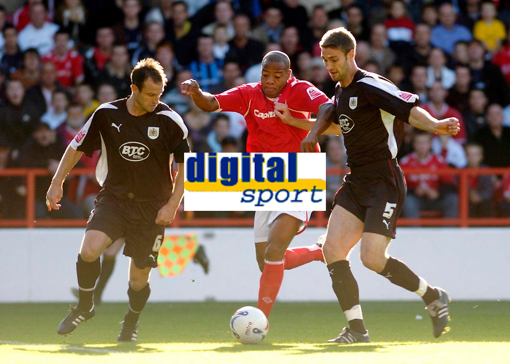 Photo: Leigh Quinnell.<br /> Nottingham Forest v Bristol City. Coca Cola League 1. 21/10/2006. Forests Junior Agogo finds a way through Bristol Citys  Jamie McCombe(L) and Louis Carey.