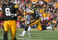 October 23 2010: Iowa Hawkeyes wide receiver Derrell Johnson-Koulianos (15) pulls in a pass during the first half of the NCAA football game between the Wisconsin Badgers and the Iowa Hawkeyes at Kinnick Stadium in Iowa City, Iowa on Saturday October 23, 2010. Wisconsin defeated Iowa 31-30.