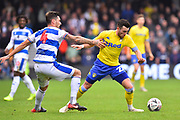 Jack Harrison (22) of Leeds United battles for possession with Grant Hall (4) of Queens Park Rangers during the The FA Cup 3rd round match between Queens Park Rangers and Leeds United at the Loftus Road Stadium, London, England on 6 January 2019.