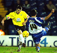 Photo: Paul Greenwood.<br />Bury v Hereford United. Coca Cola League 2. 30/01/2007. Hereford's Steve Jennings, left, shoots past Richie Baker