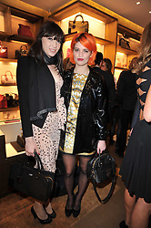 Left to right, DAISY LOWE and PIXIE GELDOF at the opening of Loewe's new boutique at 125 Mount Street, London on 23rd March 2011.