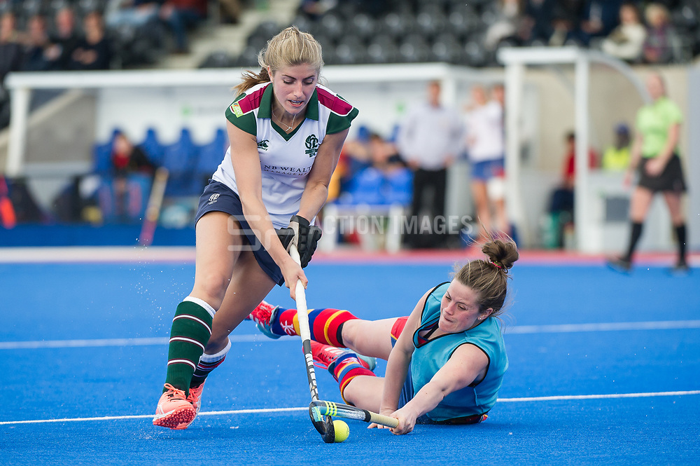 Surbiton's Sarah Haycroft is tackled by Rebecca Condie playing kicking back for University of Birmingham. University of Birmingham v Surbiton - Semi-Final - Investec Women's Hockey League Finals, Lee Valley Hockey & Tennis Centre, London, UK on 22 April 2017. Photo: Simon Parker
