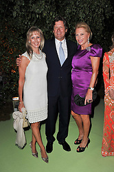 Left to right, SUSAN CROSSLEY,  JEREMY WILKINS and EVA O'NEILL at a dinner hosted by Cartier in celebration of the Chelsea Flower Show held at Battersea Power Station, 188 Kirtling Street, London SW8 on 23rd May 2011.