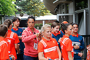 Roland Garros. Paris, France. June 1st 2012.A day with the ball boys..A coach help a Gaelle with her hair