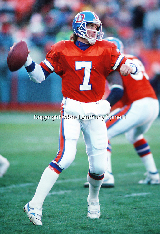 Denver Broncos quarterback John Elway (7) throws a pass during the NFL football game against the Los Angeles Raiders on Dec. 2, 1990 in Denver. The Raiders won the game 23-20. (©Paul Anthony Spinelli)
