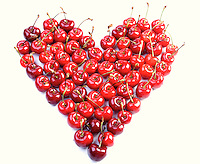 Cherries on white background - heart shape
