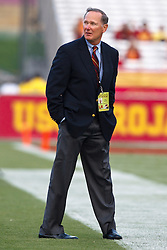 September 11, 2010; Los Angeles, CA, USA;  Southern California Trojans athletic director watches warm ups from the sidelines before the game against the Virginia Cavaliers at the Los Angeles Memorial Coliseum.