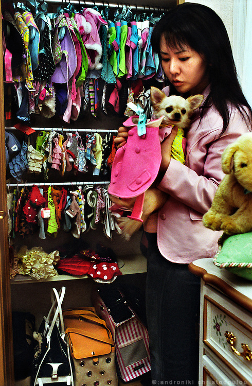 Trying clothes..Closet for dog clothes in the special dog-bedroom of Shoko Mizuta's house..Osaka April 2004