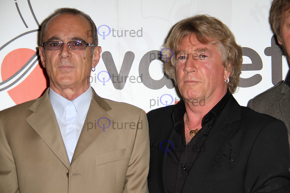 Francis Rossi; Rick Parfitt The Variety Club Status Quo Tribute Lunch, Dorchester Hotel, Park Lane, London, UK, 23 September 2010: For piQtured Sales contact: Ian@Piqtured.com +44(0)791 626 2580 (Picture by Richard Goldschmidt)