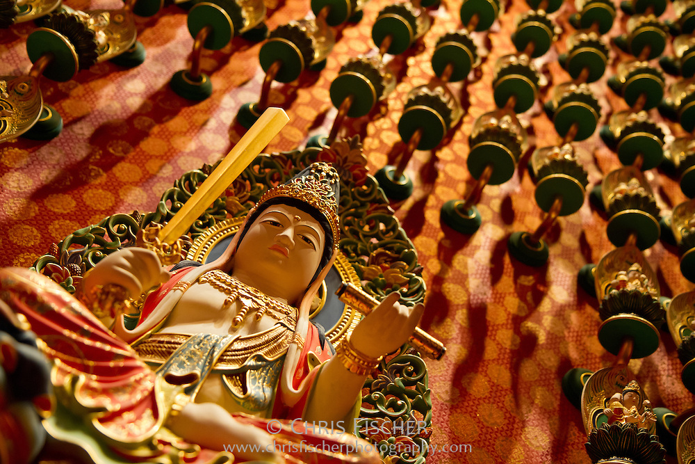 Statues of Akasagarbha, protector of those born in the year of Ox, Tiger.  Buddha Tooth Relic Temple and Museum, Singapore.