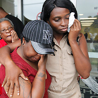 Latorcha Montgomery (center), 38, the sister of taxi driver Charles Montgomery, and Danielle Richardson (right), 39, mourn together after a bond hearing Monday for Michael Kenneth Moore Jr., 17, who is accused of fatally shooting Montgomery on Sunday in North Charleston. (ANDREW KNAPP/STAFF)