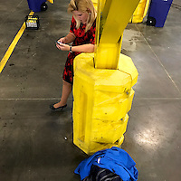 A member of the media checks her phone after Republican Vice Presidential hopeful Mike Pence campaigned at Penn Waste in York, PA on September 29, 2016.