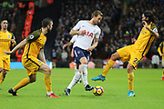 Harry Kane of Tottenham Hotspur (10) dribbling and taking on Brighton and Hove Albion defender Ezequiel Schelotto (21) during the Premier League match between Tottenham Hotspur and Brighton and Hove Albion at Wembley Stadium, London, England on 13 December 2017. Photo by Matthew Redman.