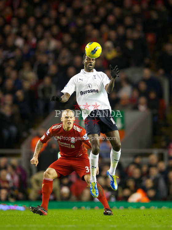 LIVERPOOL, ENGLAND - Monday, February 6, 2012: Liverpool's Martin Skrtel in action against Tottenham Hotspur's Emmanuel Adebayor during the Premiership match at Anfield. (Pic by David Rawcliffe/Propaganda)