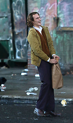 "Joaquin Phoenix is pictured for the first time playing the title role for the upcoming ""JOKER"" movie in which he lost a lot of weight to play the part. The movie takes place on a 1980s gritty New York City. The movie was being filmed in Manhattan's Harlem area. At one point during a scene that required him to kick stuff around he hurt his foot and was seen carrying a bag of ice. 16 Sep 2018 Pictured: Joaquin Phoenix. Photo credit: LRNYC / MEGA TheMegaAgency.com +1 888 505 6342"