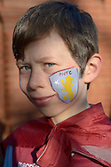 a Young Aston Villa fan wearing Aston Villa paint on his face outside Villa Park before k/o. The FA cup, 6th round match, Aston Villa v West Bromwich Albion at Villa Park in Birmingham, Midlands on Saturday 7th March 2015<br /> pic by John Patrick Fletcher, Andrew Orchard sports photography.