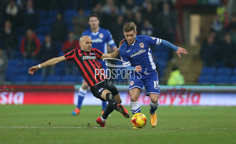 Conor McAleny and Bruno Saltor, Brighton defender during the Sky Bet Championship match between Cardiff City and Brighton and Hove Albion at the Cardiff City Stadium, Cardiff, Wales on 10 February 2015.