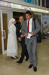 OSIJEK, CROATIA - Monday, October 15, 2012: Wales' manager Chris Coleman arrives at Osijek Airport ahead of the Brazil 2014 FIFA World Cup Qualifying Group A match against Croatia. (Pic by David Rawcliffe/Propaganda)