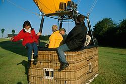 GERMANY SCHLESWIG-HOLSTEIN KIEL 9JUN02 - Passengers carefully leave the balloon's basket, as the sudden reduction in weight may cause the craft to take off once again.....jre/Photo by Jiri Rezac..© Jiri Rezac 2002..Contact: +44 (0) 7050 110 417..Mobile:  +44 (0) 7801 337 683.Office:  +44 (0) 20 8968 9635..Email:   jiri@jirirezac.com.Web:     www.jirirezac.com