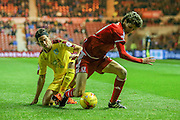 Burnley midfielder George Boyd  fouls Middlesbrough forward, on loan from Watford, Diego Fabbrini  during the Sky Bet Championship match between Middlesbrough and Burnley at the Riverside Stadium, Middlesbrough, England on 15 December 2015. Photo by Simon Davies.