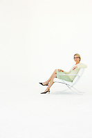 Business woman sitting in chair portrait